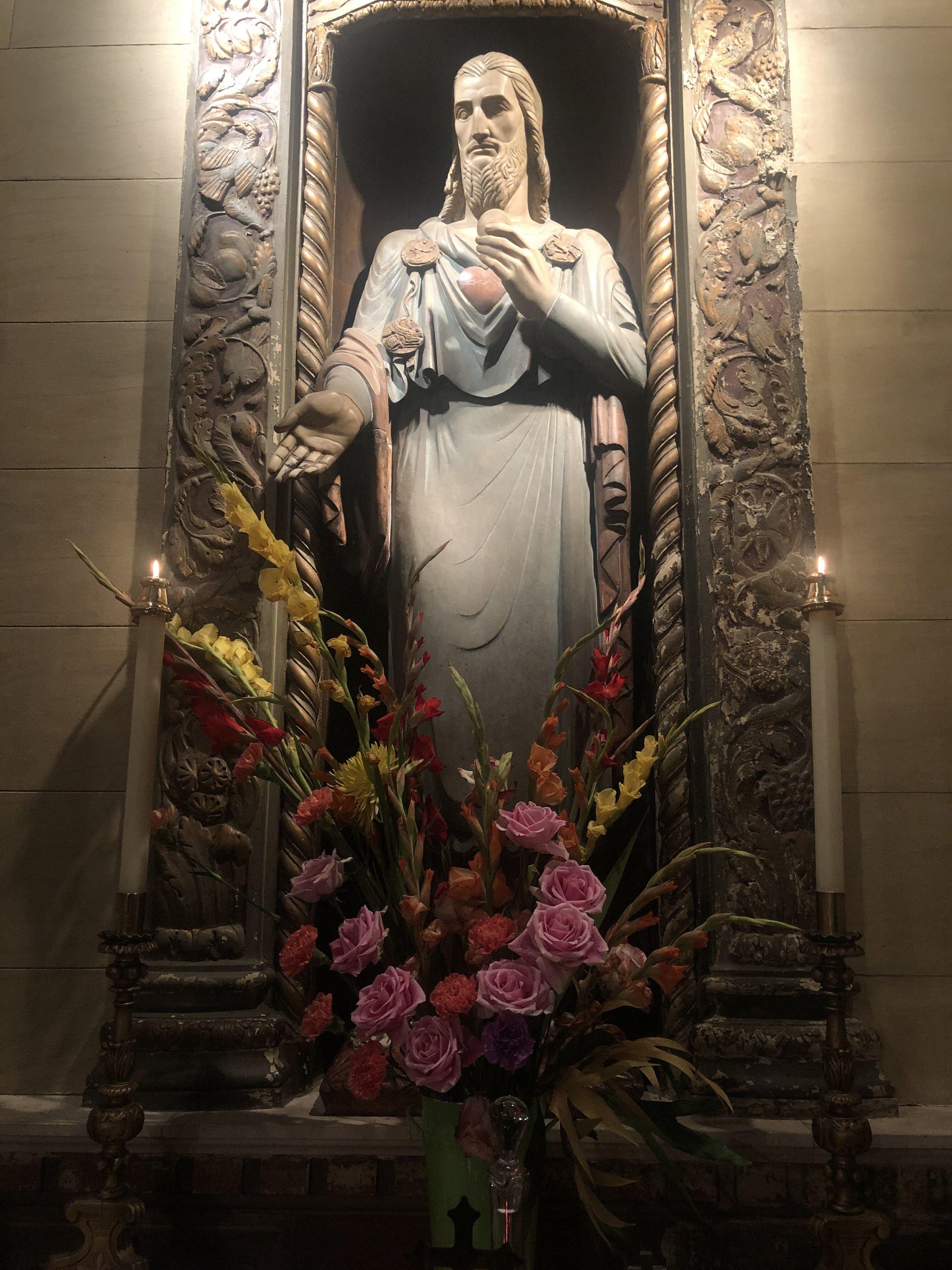 The Sacred Heart of Jesus, by Lee Lawrie (1877-1963). Flower design by Dexter Baksh.   Photo:  Brendon Hunte