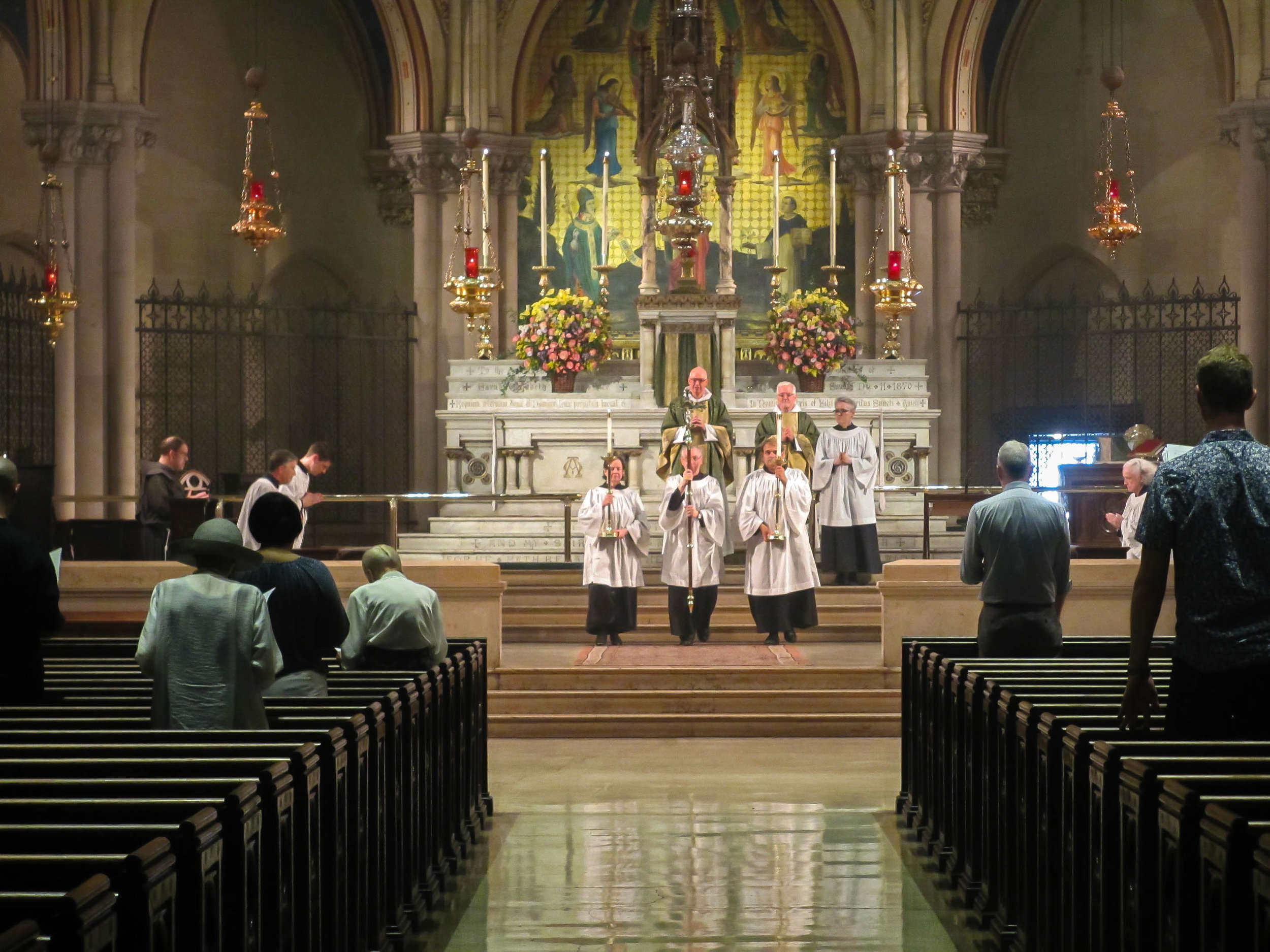 """On Sunday, July 28, 2019, """"Ye servants of God, your Master proclaim"""" is sung as the retiring procession leaves the chancel.  Photo:  MaryJane Boland"""