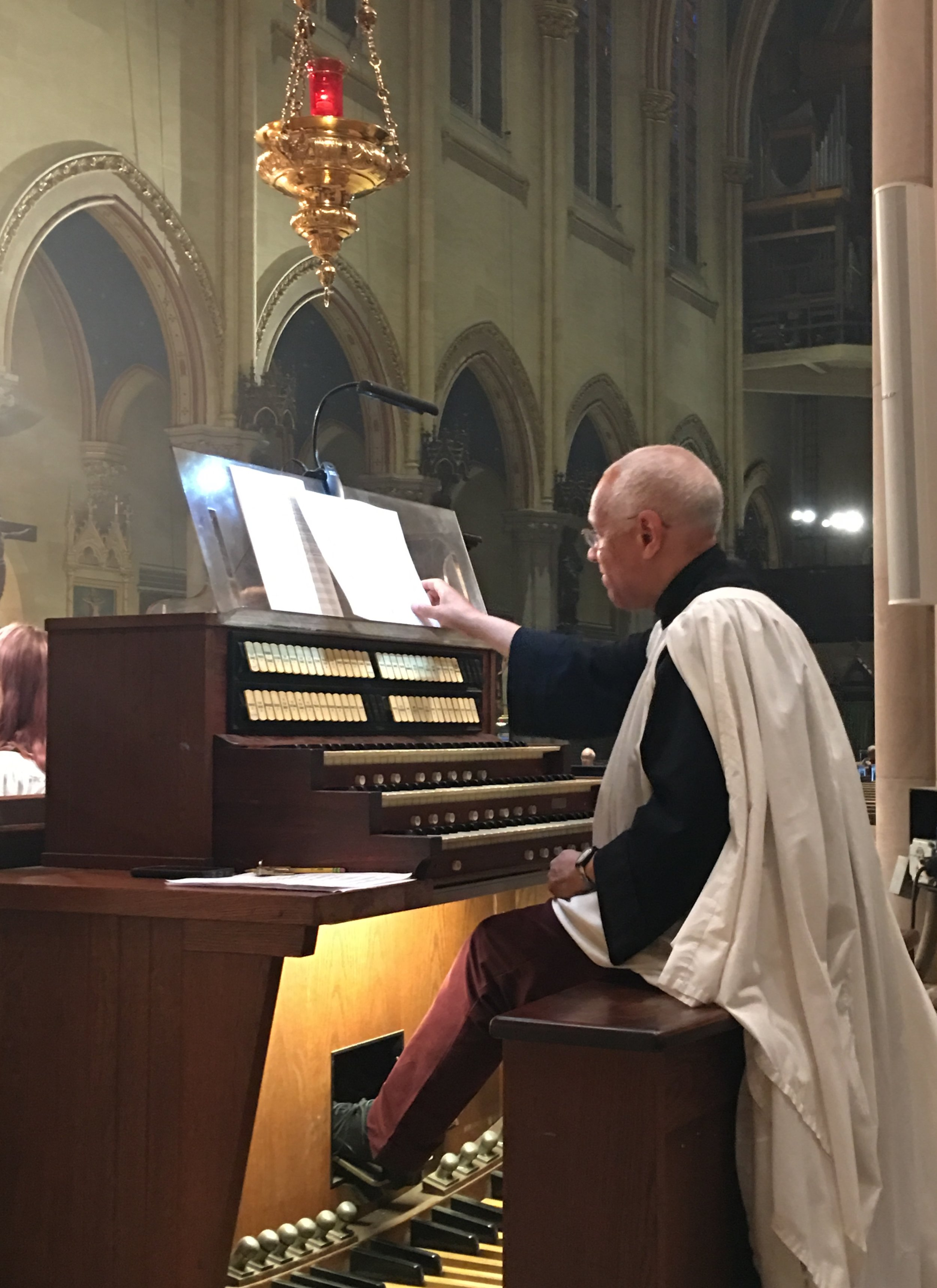 Dr. David Hurd at the organ console in the chancel during the Liturgy of the Word at the Solemn Mass.  Photo:  Renee Pecquex