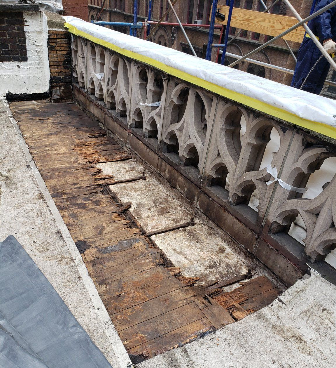 Mission House balustrade after cleaning. Some of the 1895 wood roofing material will need replacement.    Photo:  Milan Restoration