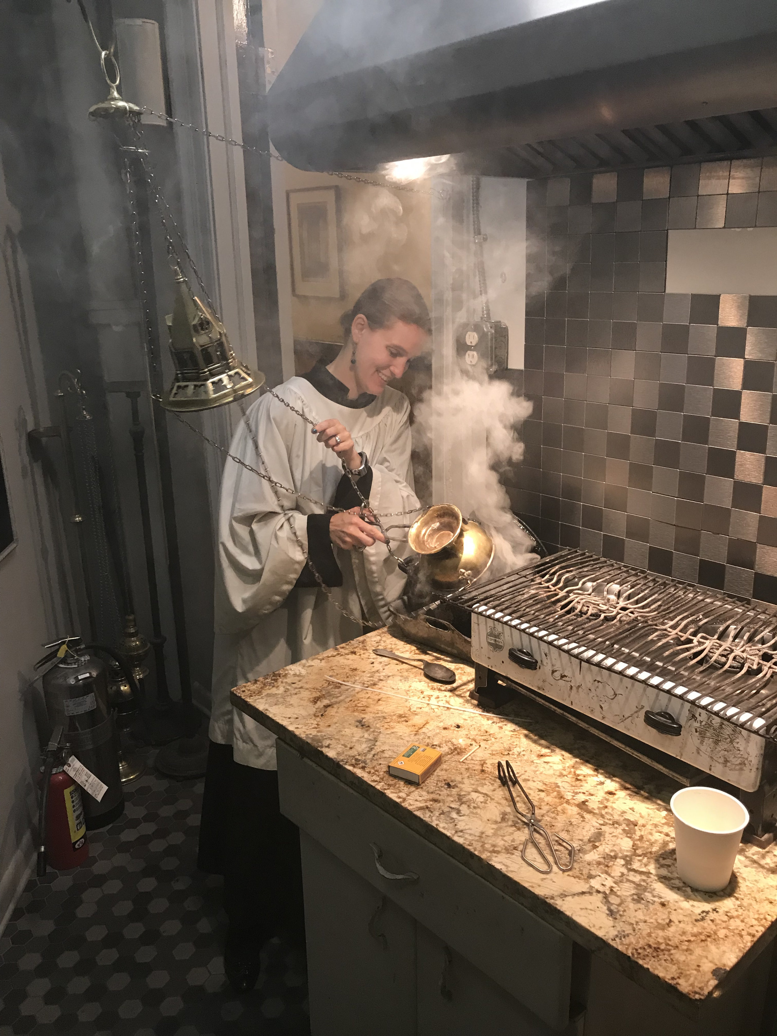 Behind the scenes in the Smoke Room on Sunday, August 18. Grace Mudd served as thurifer.  Photo:  Clark Mitchell