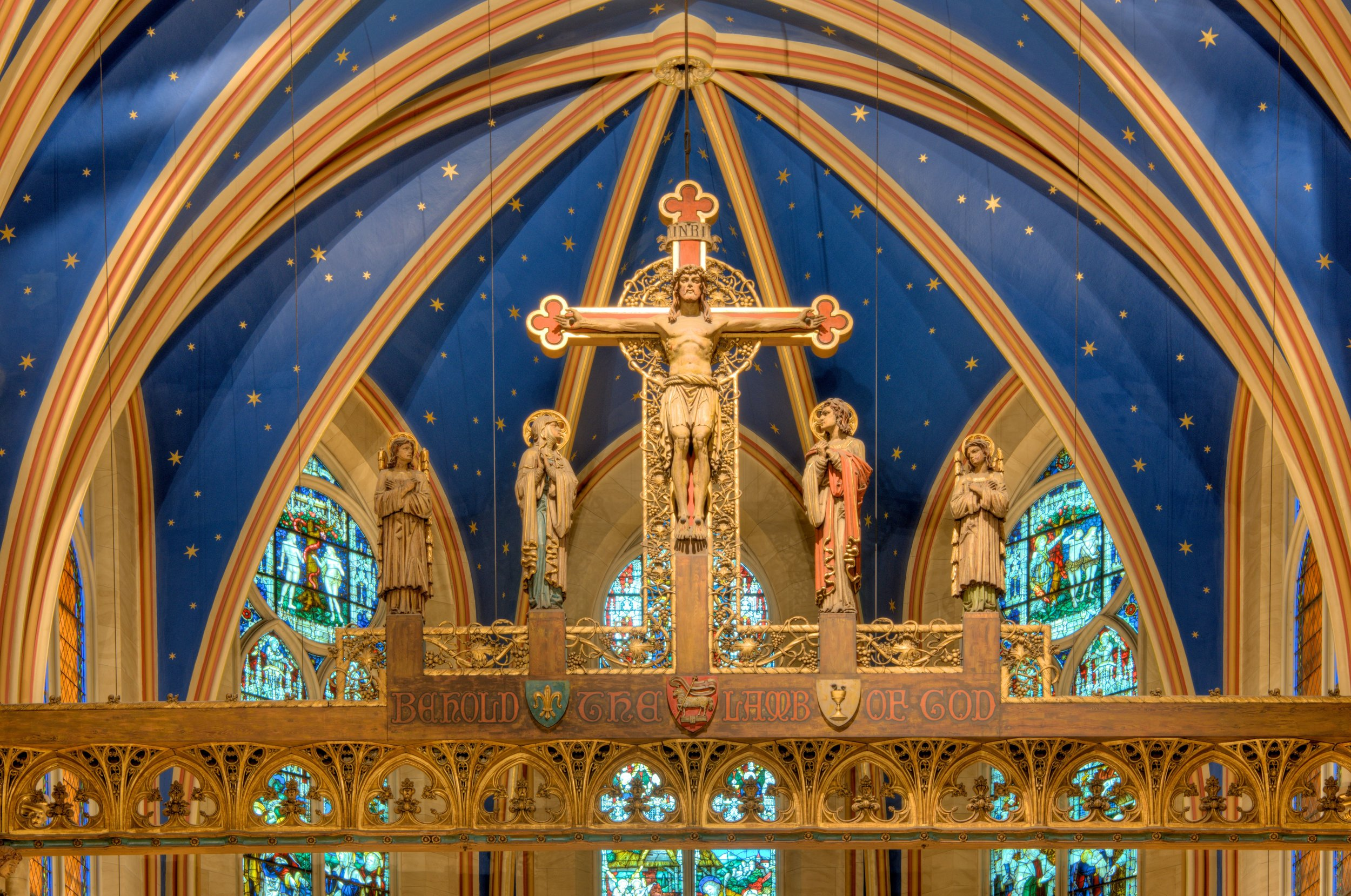 The Rood Beam at Saint Mary's (1912) by Johannes Kirchmayer (1860-1930). At the foot of the Cross stand the the Blessed Virgin and Saint John the Evangelist, flanked by two angels.   Photo:  Brian Kutner