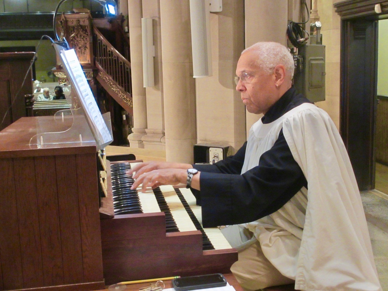Dr. David Hurd plays the service at the downstairs console.  Photo:  MaryJane Boland