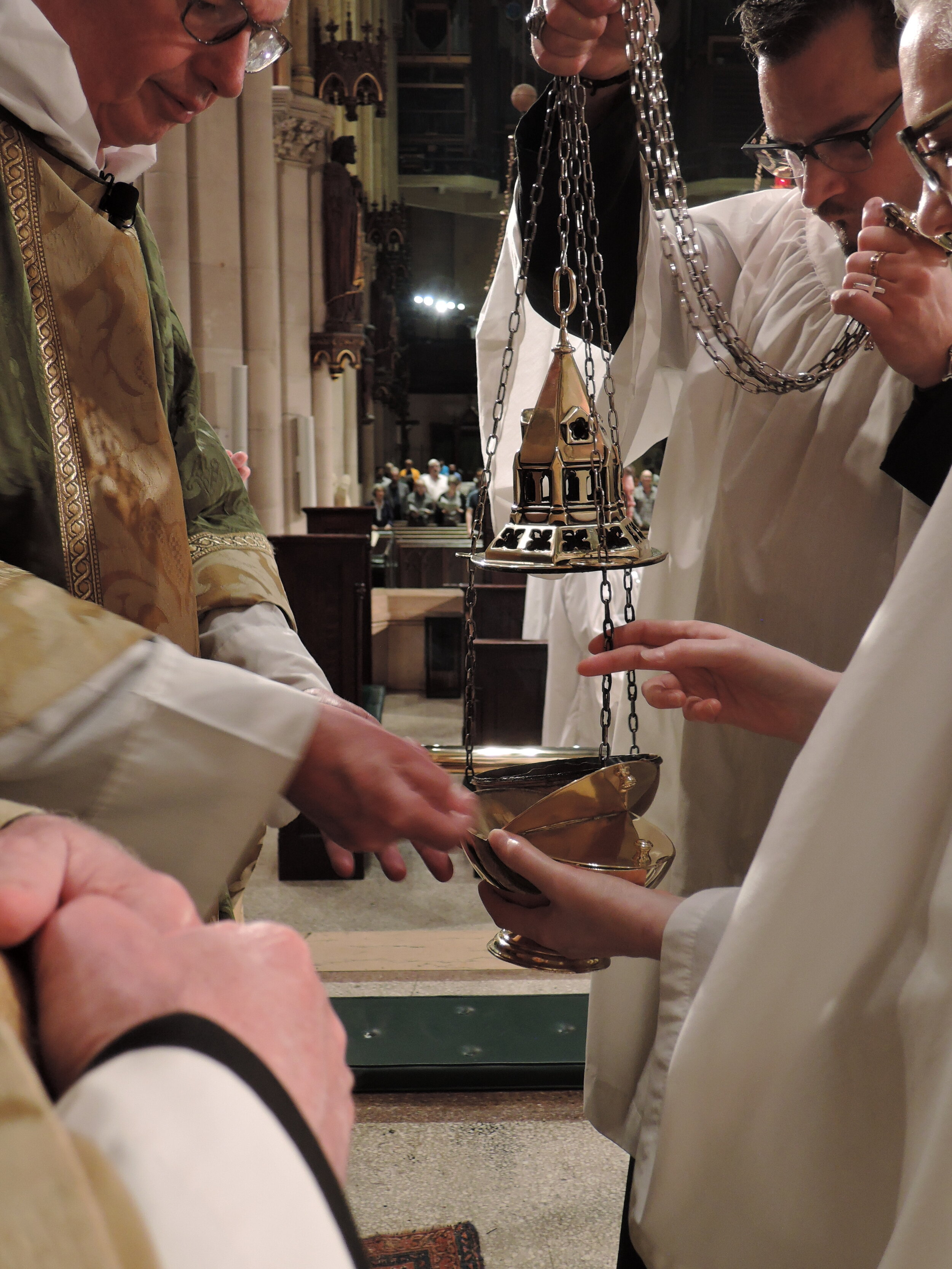 The thurible is charged before the proclamation of the gospel.    Photo:  Grace Mudd