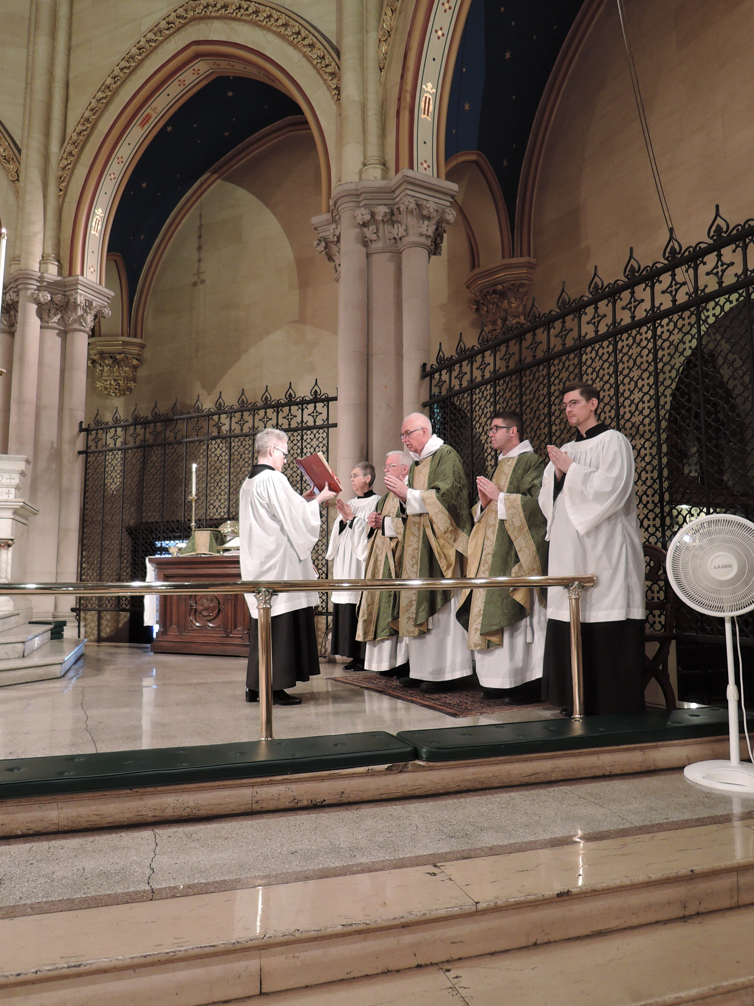 The concluding collect of the prayers of the people has just been prayed by the celebrant.  Photo:  Grace Mudd