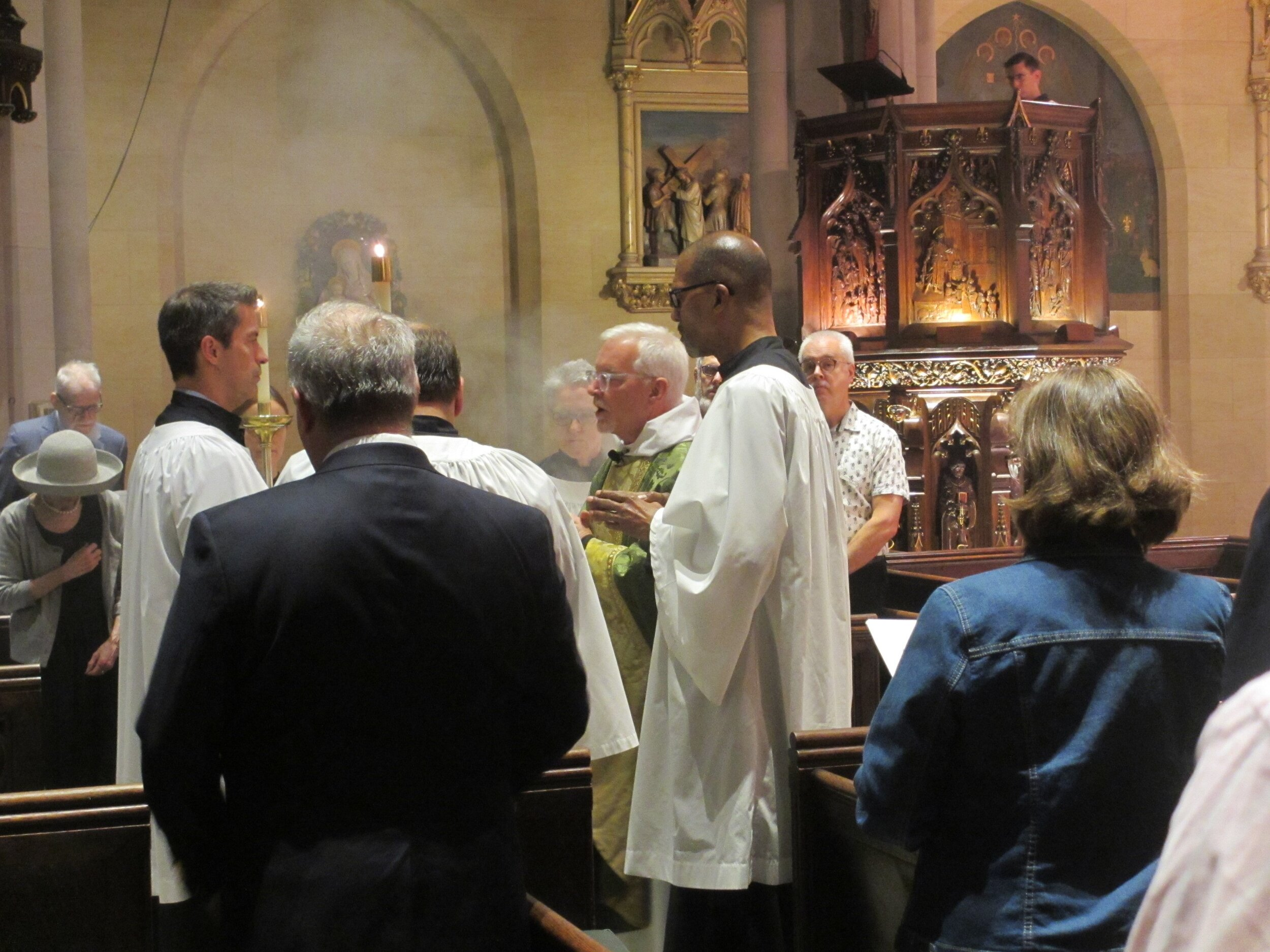 Sunday, September 22, 2019: Father Jim Pace at the beginning of the proclamation of the gospel (before the book is censed) at the Solemn Mass. After the gospel book is censed, the thurifer will stand directly behind the gospeller. Incense will continue to rise while the gospel is proclaimed.  Photo:  MaryJane Boland
