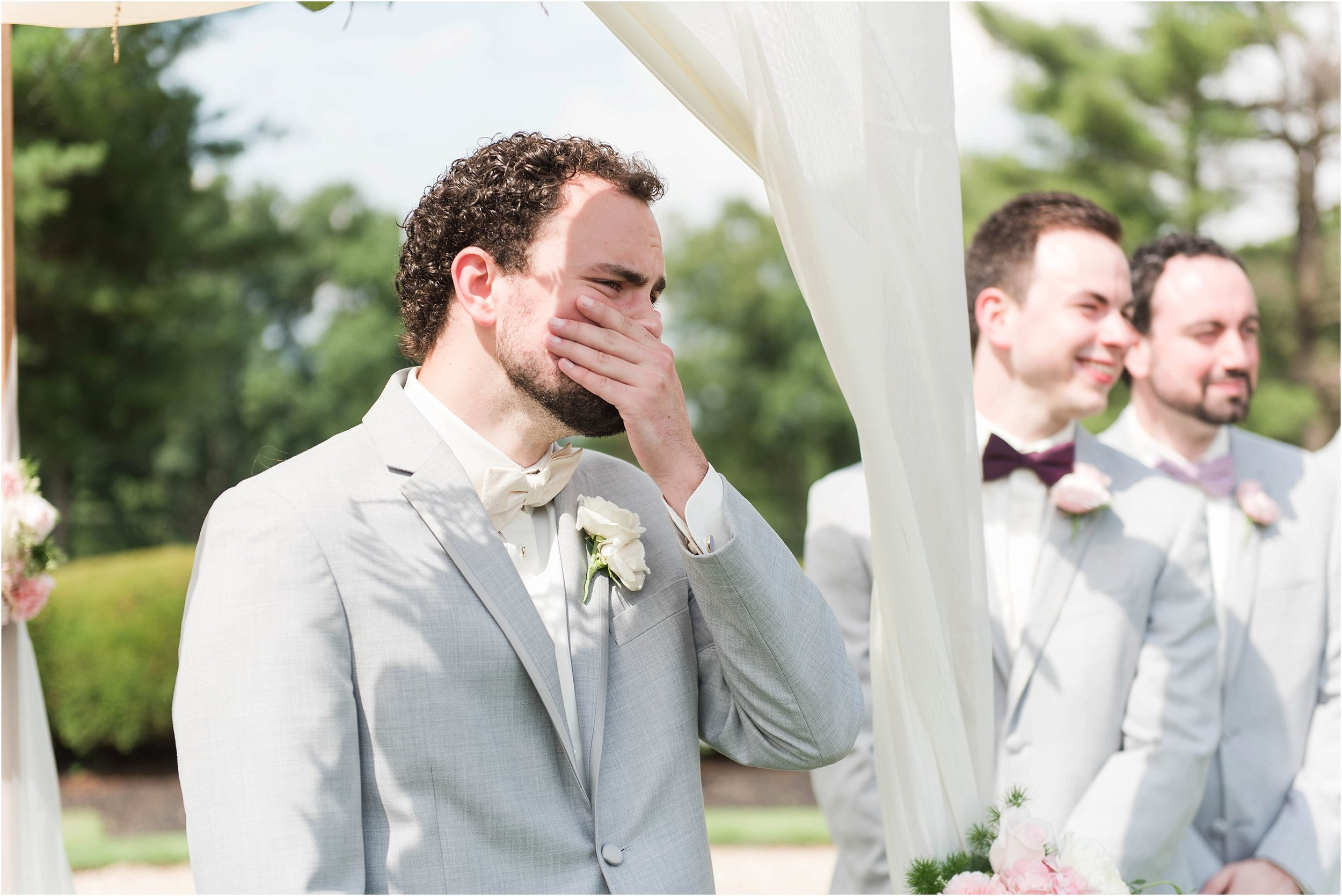 This photo of Nathan was taken by my second shooter, Haley Nelson, while I photographed Taylor walking down the aisle!