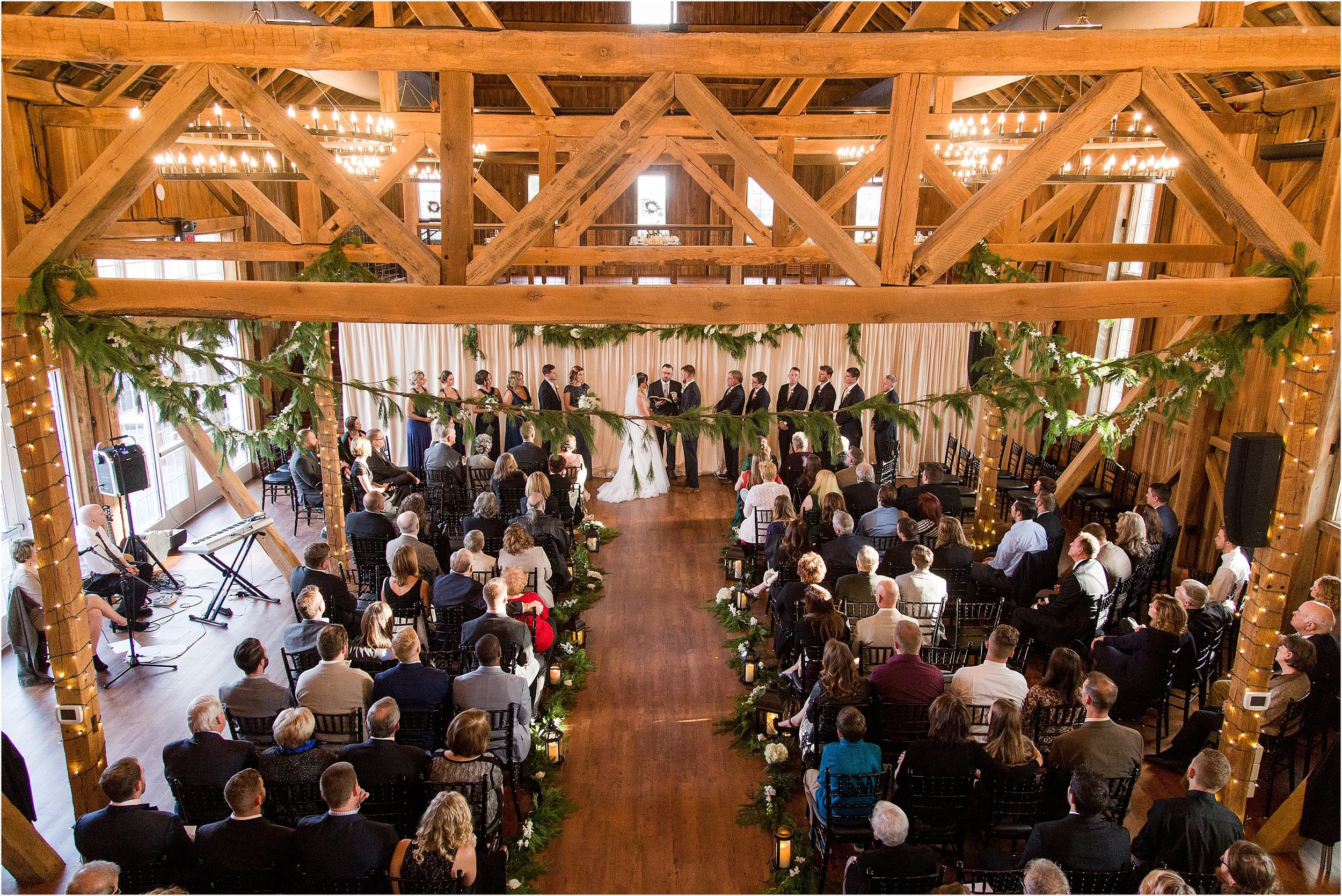While I was getting close shots of Dan & Kendra, my second, Alyssa Eckhart, went into the balcony to get this awesome wide shot of their ceremony at Wyndridge!
