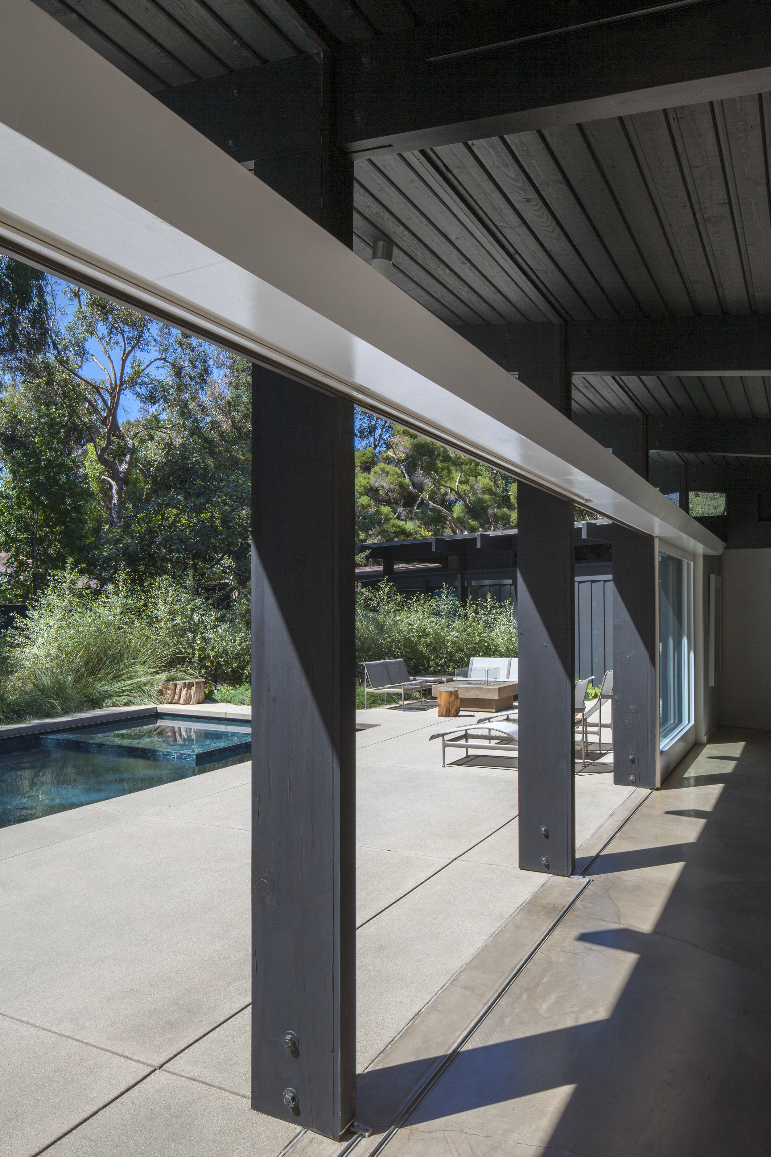 Sleek modern patio shade structure view view of minimal custom built pool - Rustic Canyon - Los Angeles garden design by Campion Walker Landscapes.jpg