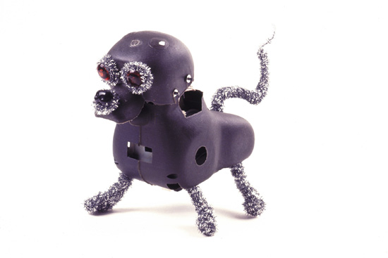 "Armored Dog  , 2003  Battery-operated toy dog stripped down to its plastic skeleton decorated with fingernail polish and tinsel pipe cleaners, 5-5/16"" x 3-3/4"" x 7-1/2"""