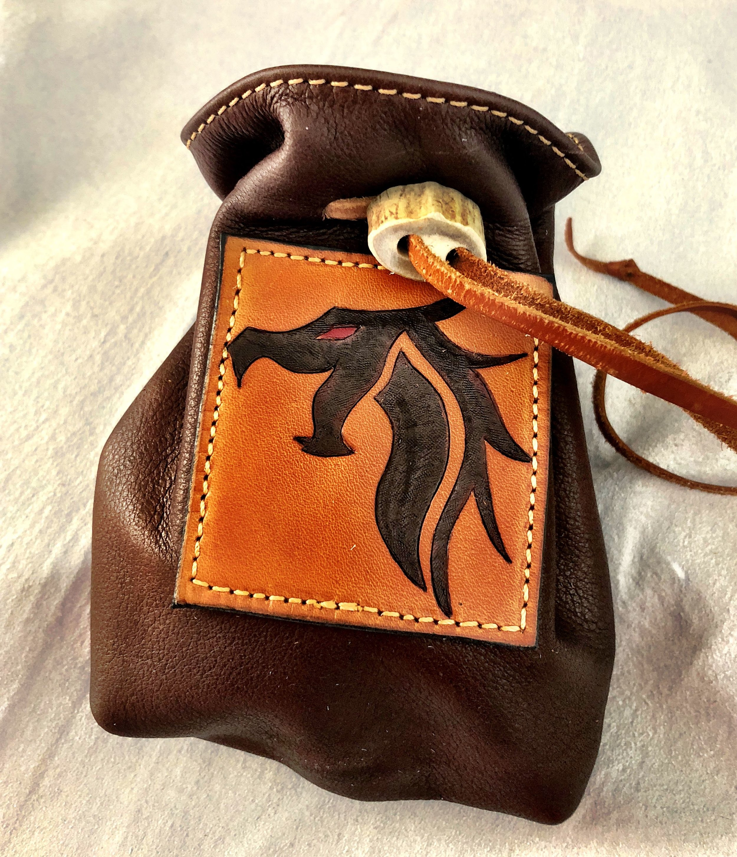 A dontation bag for Dragon Fall (Convention) and thier fund raiser.