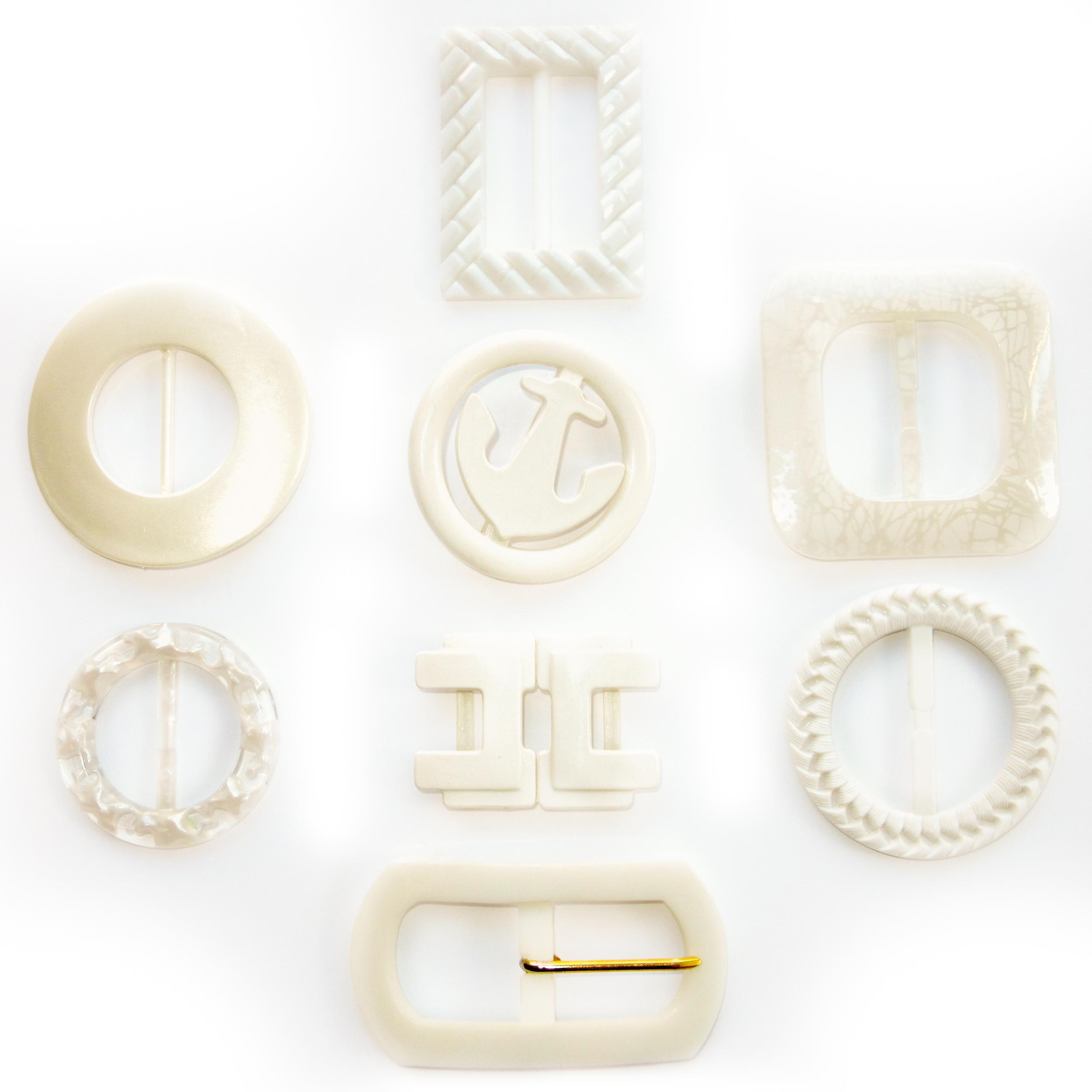 White plastic belt buckles