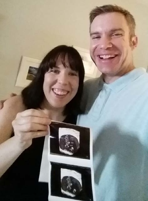 My Husband and I showing our ultrasound from 8 weeks. Can't Wait to Be Mom and DAd! :)