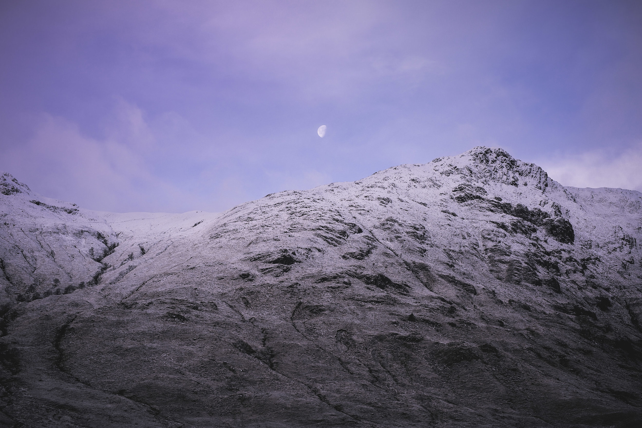 You get to see views like this! Purple skies and the moon, what more could you want.