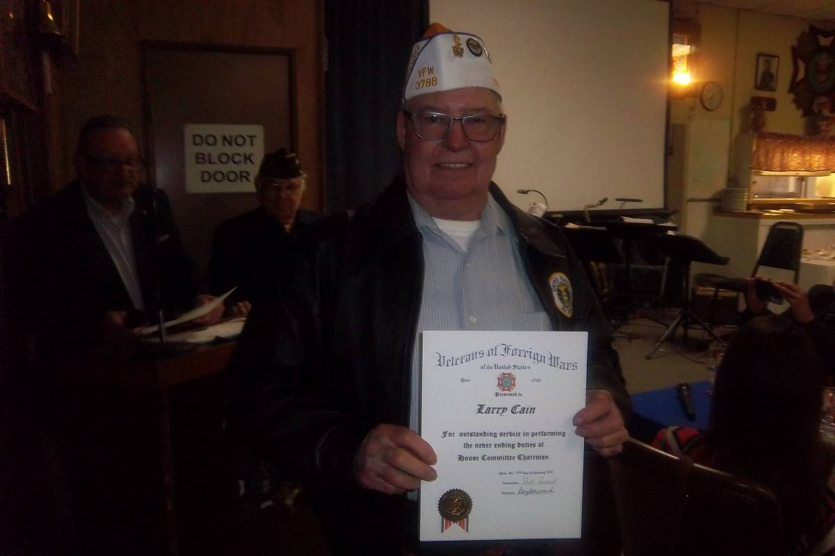 Larry Cain showing his citation.jpg