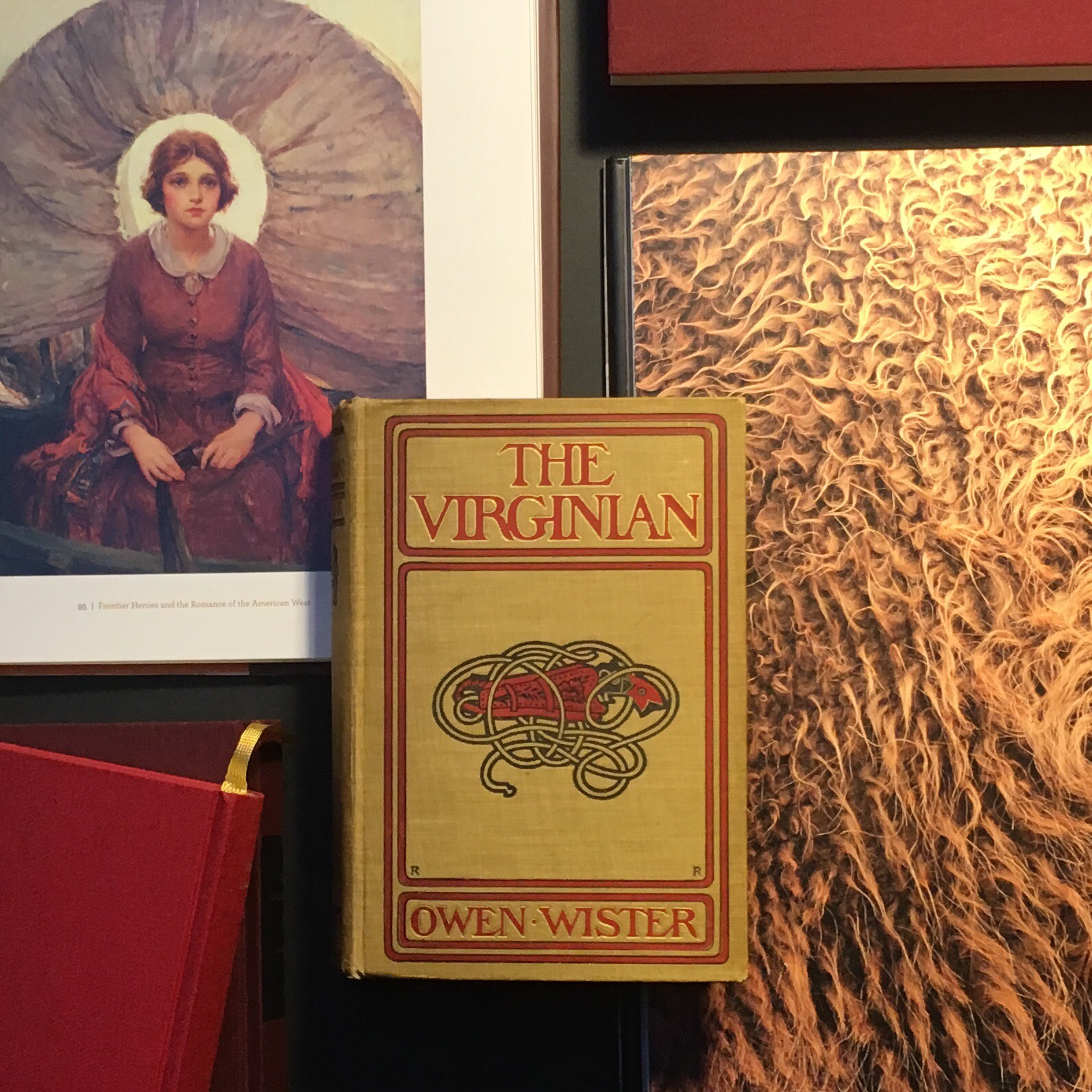 First edition of Owen Wister's  The Virginian . Private collection. Pictured here with  Buffalo Ballad  and  Art of the American Frontier . Painting: 'Madonna on the Prairie' by W.H.D. Koerner, 1921.