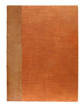 Fine first edition of   Taos Pueblo,   bound in original quarter tan morocco over orange buckram. Grabhorn Press, 1930.