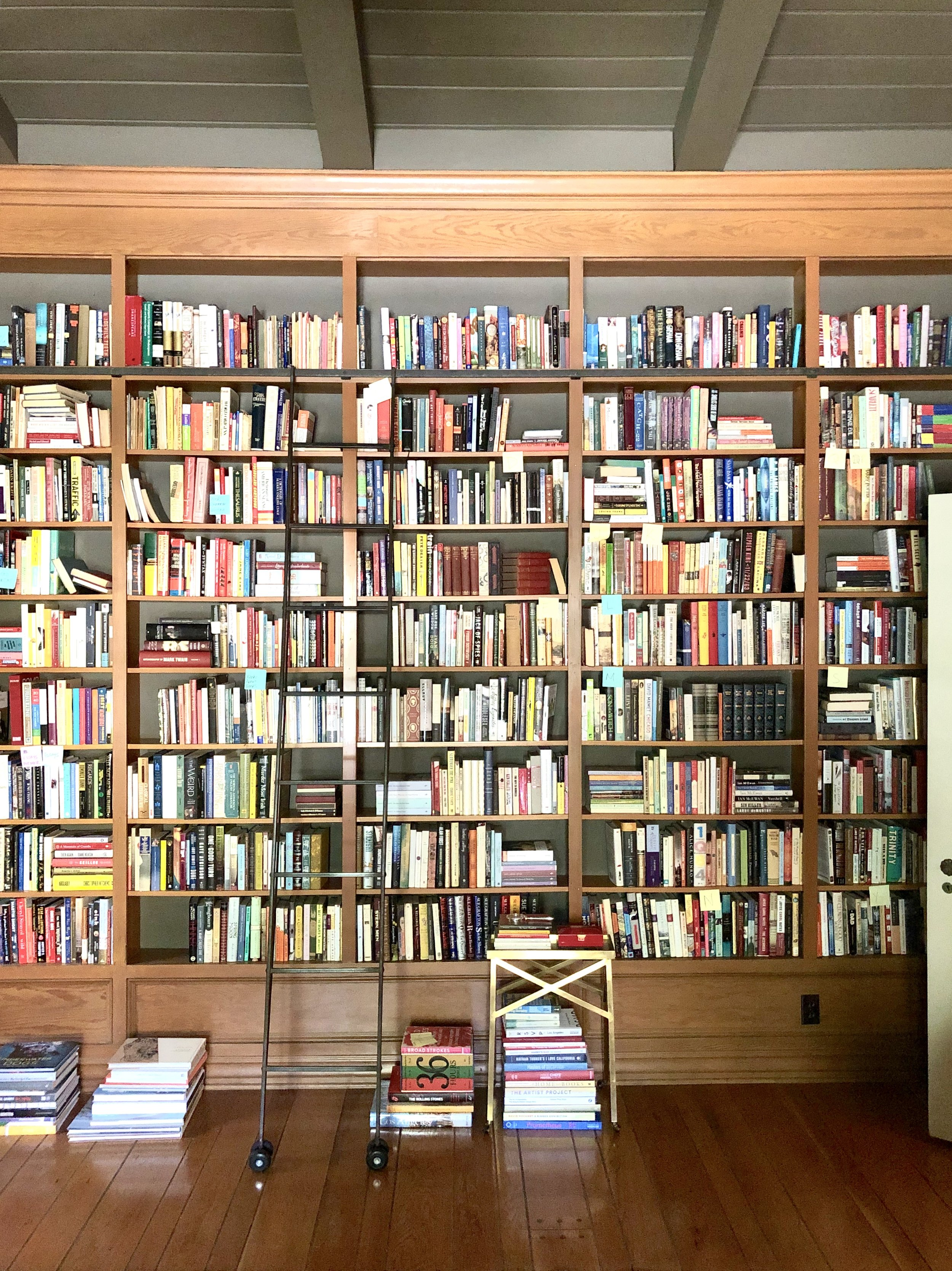Organization in process: the fiction & literature section being alphabetized. Los Angeles-area residential library.