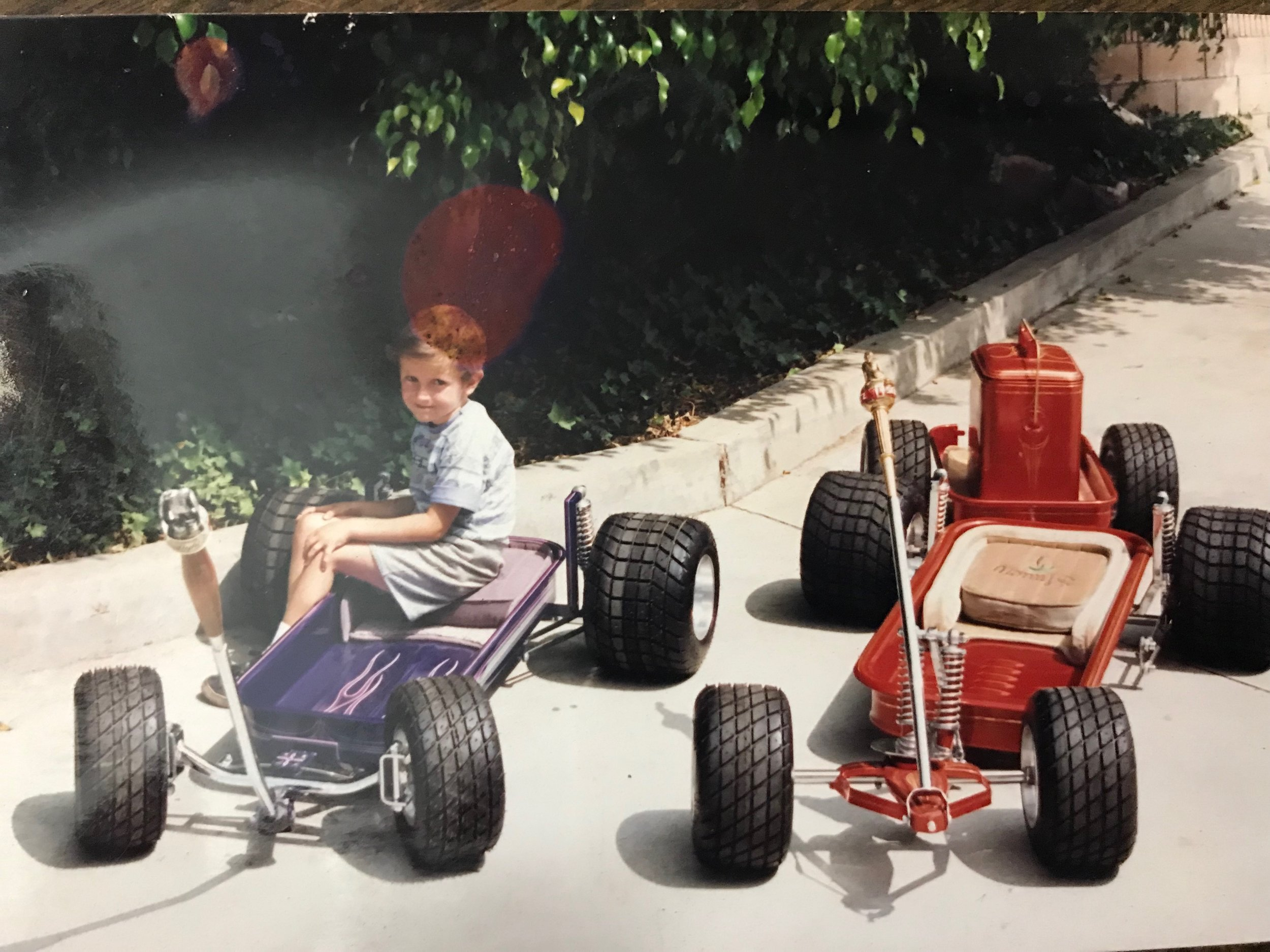 Shawn with his 1st 2 wagons his dad built in 1992
