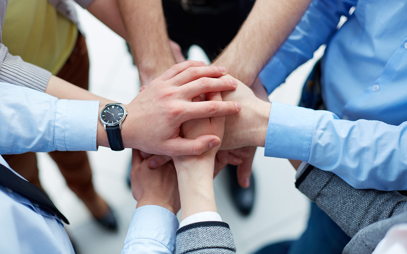 FreeGreatPicture.com-50265-people-gesture-of-unity-and-cooperation.jpg