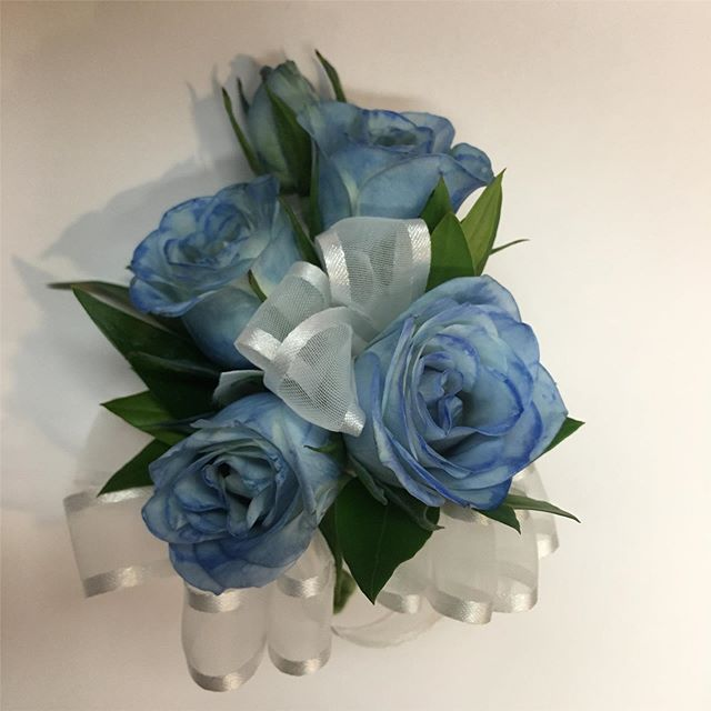 A blue rose & sliver wrist corsage, perfect for #prom season.