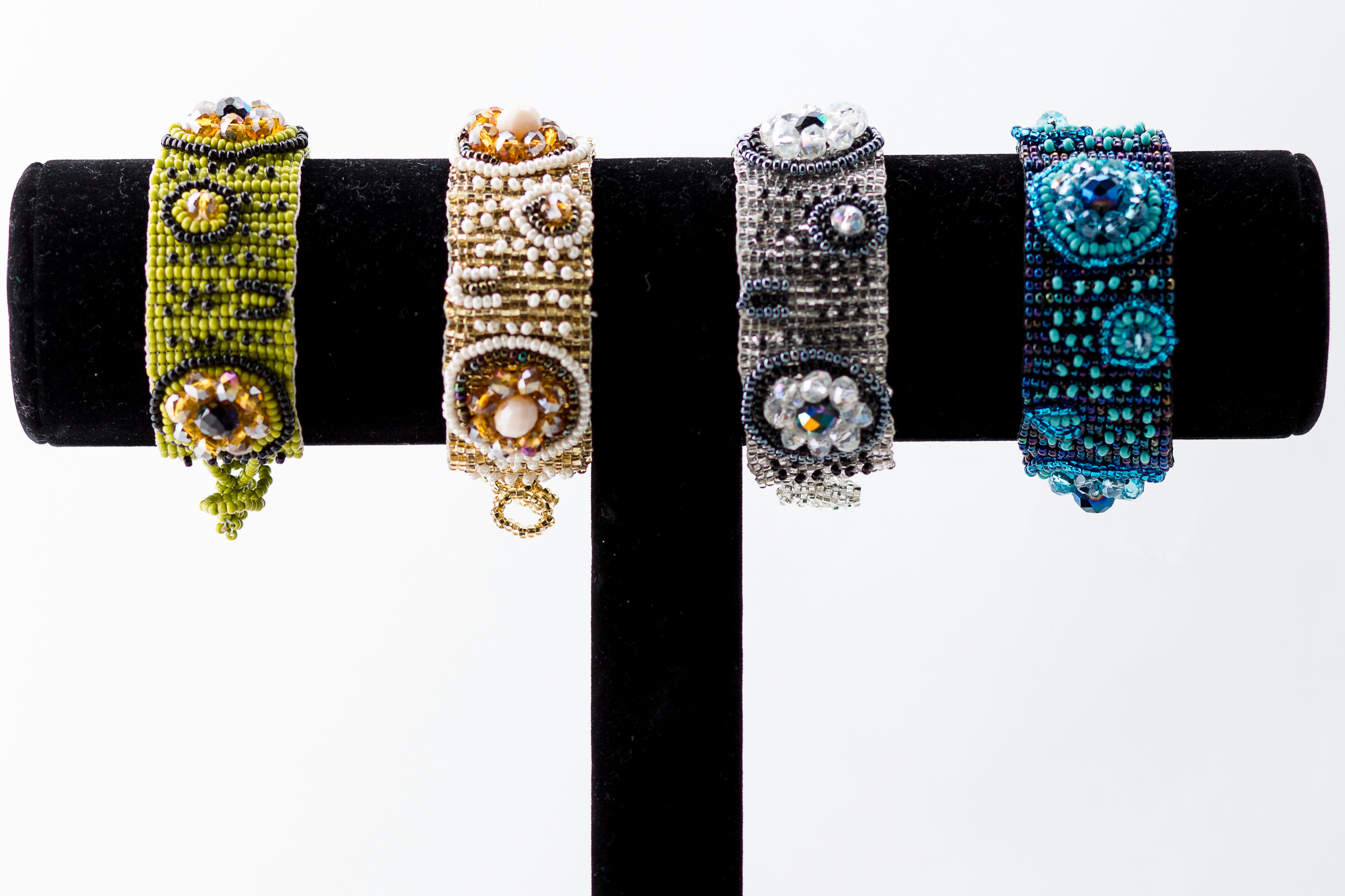 BEADED BRACELET WITH colored STONES (1 IN WIDE). CLASP DESIGN ALLOWS FOR 7, 7 1/2 AND 8 IN LENGTHS.