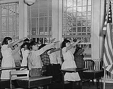 American School Children Saluting the American flag (est. 1940 - WikiCommons)