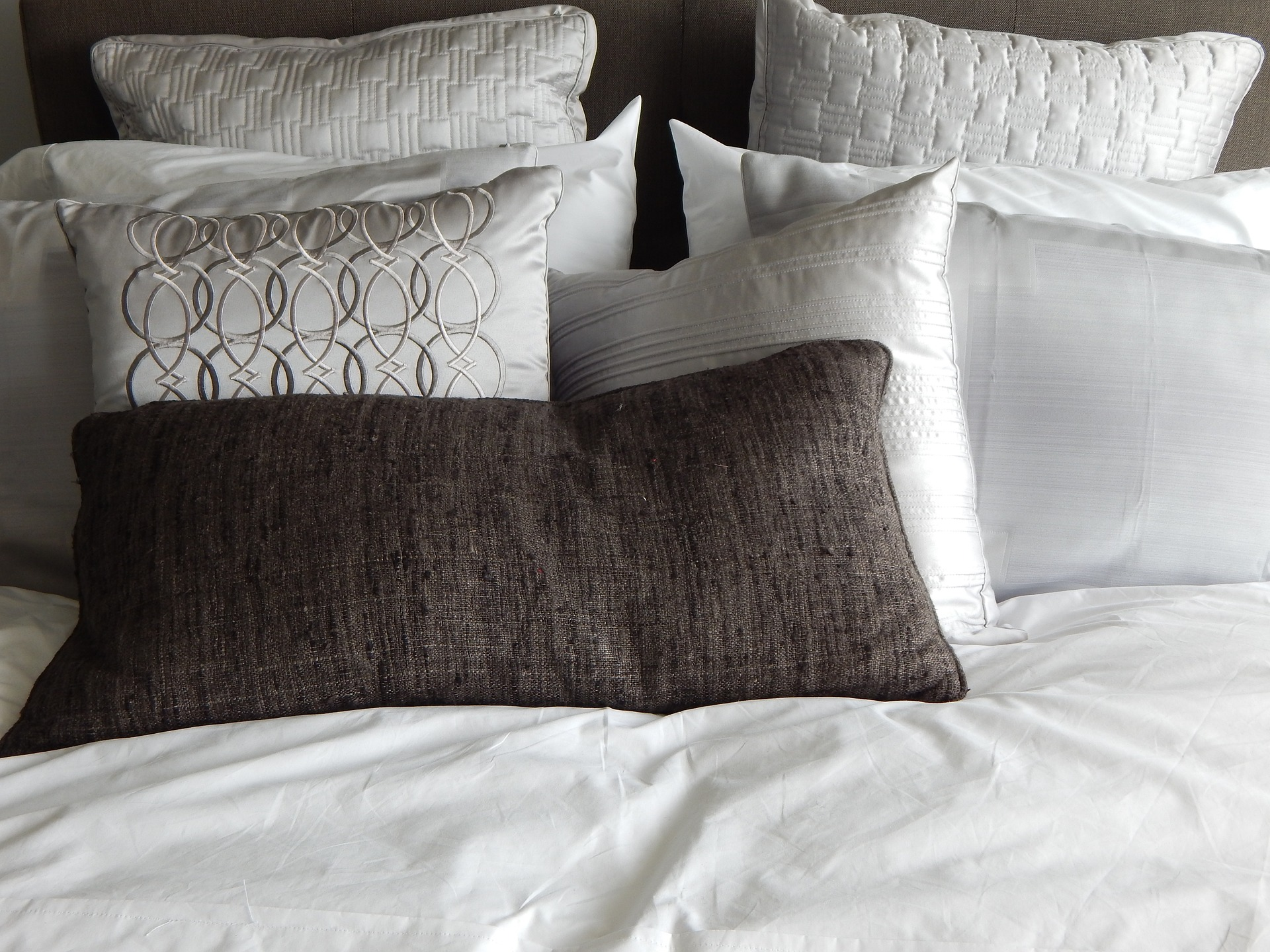 bed nicely made fresh linen