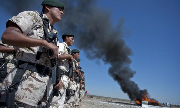 Mexican soldiers burning marijuana, cocaine, heroin and other drugs in Ciudad Juarez, Chihuahua. Photograph: AFP/Getty