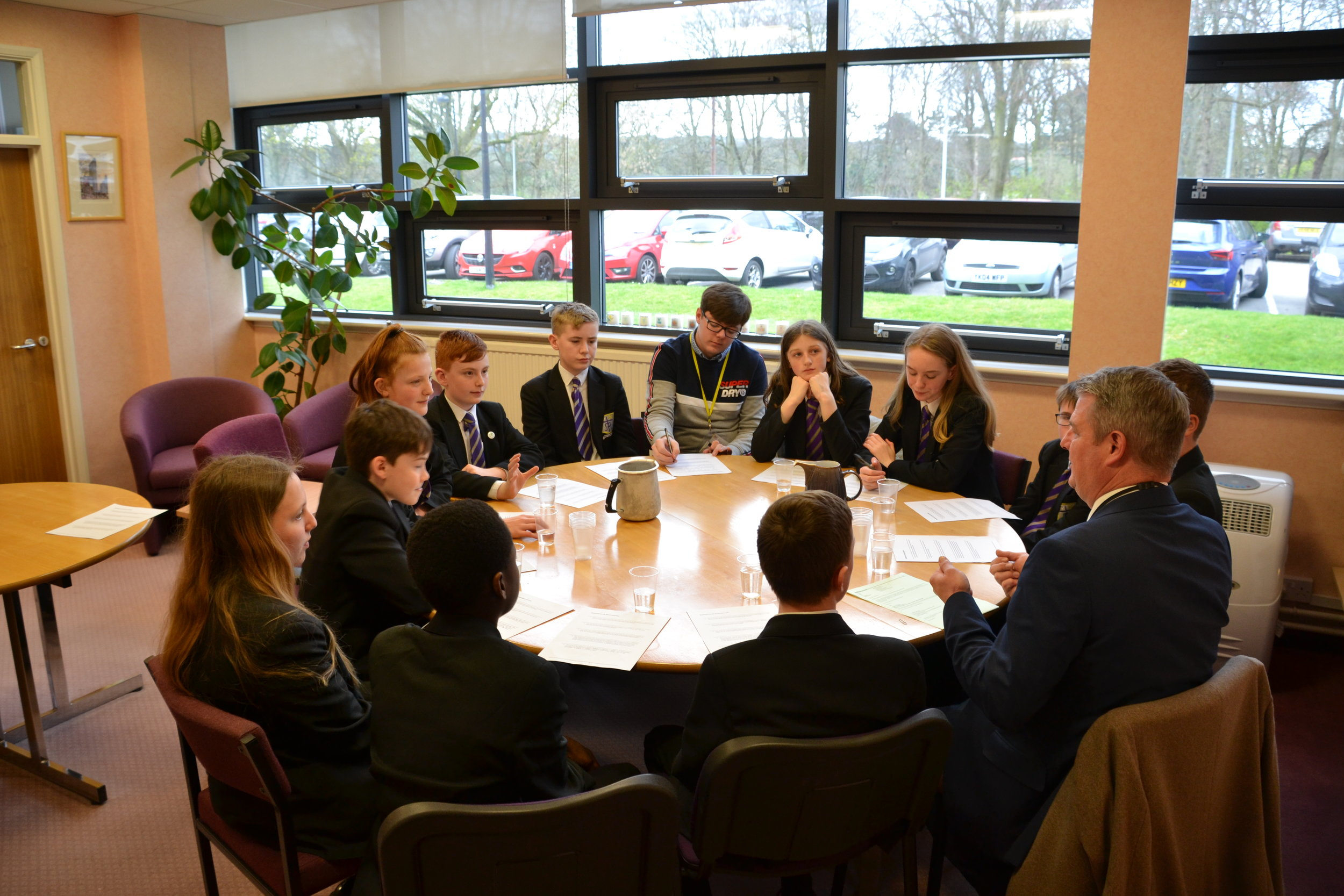 Tom with the Global Warriors Group in discussion with their local MP, Stuart Adams