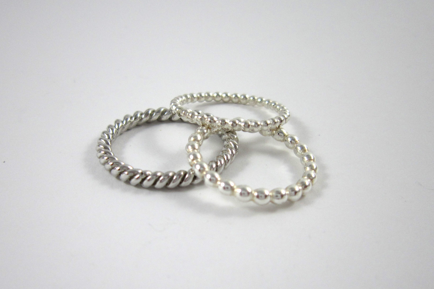 Zilveren ringen.