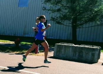 Theresa Loomis racing in the YMCA 10 miler in May 2016.