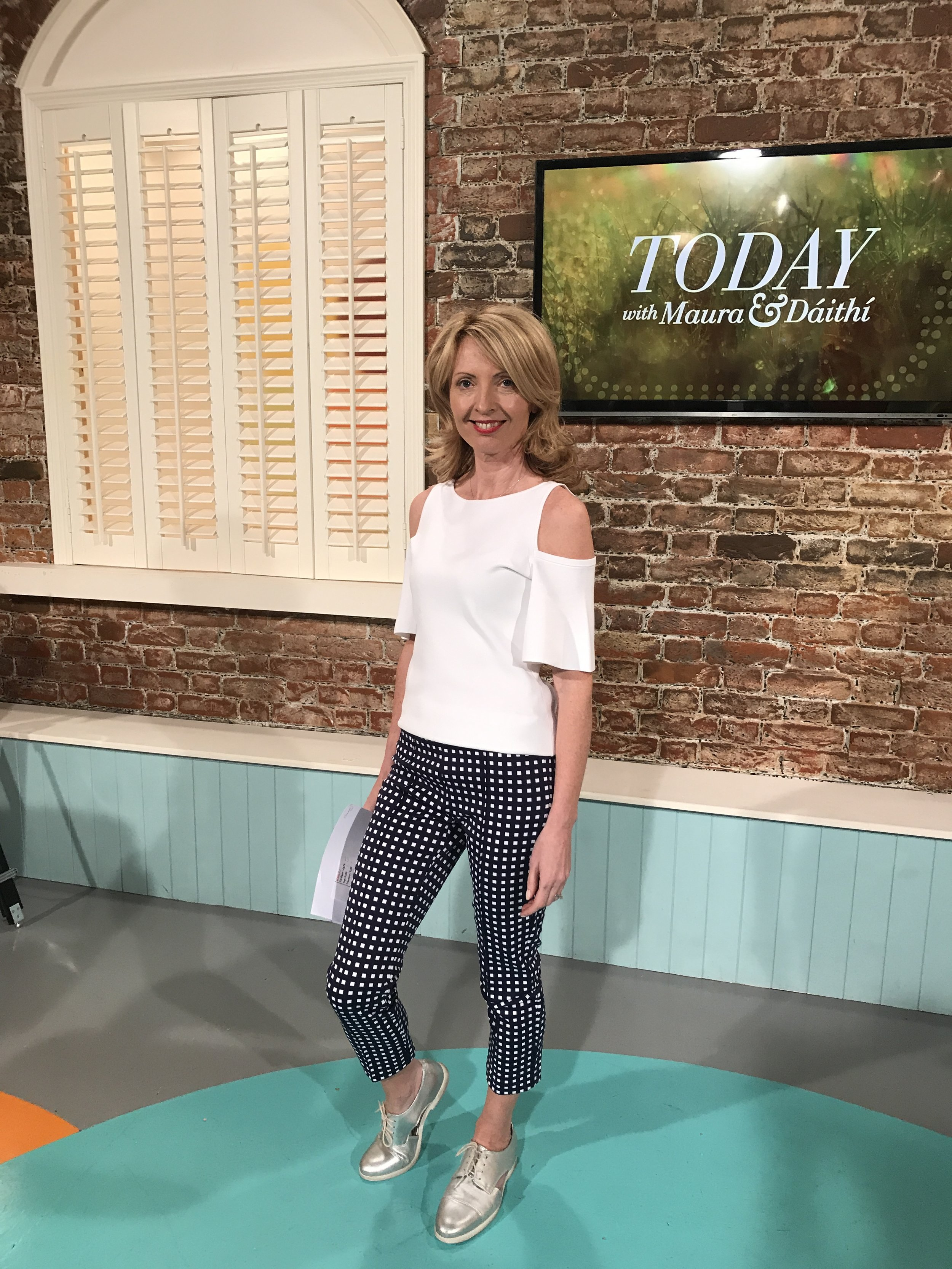 The white Michael Kors cut out (cold shoulder) jumper is very much a trend, but the cigarette pants are timeless (think Marilyn Monroe below) - and together with silver shoes they make a statement ! (Look by MacBees Killarney as seen on RTE Today)