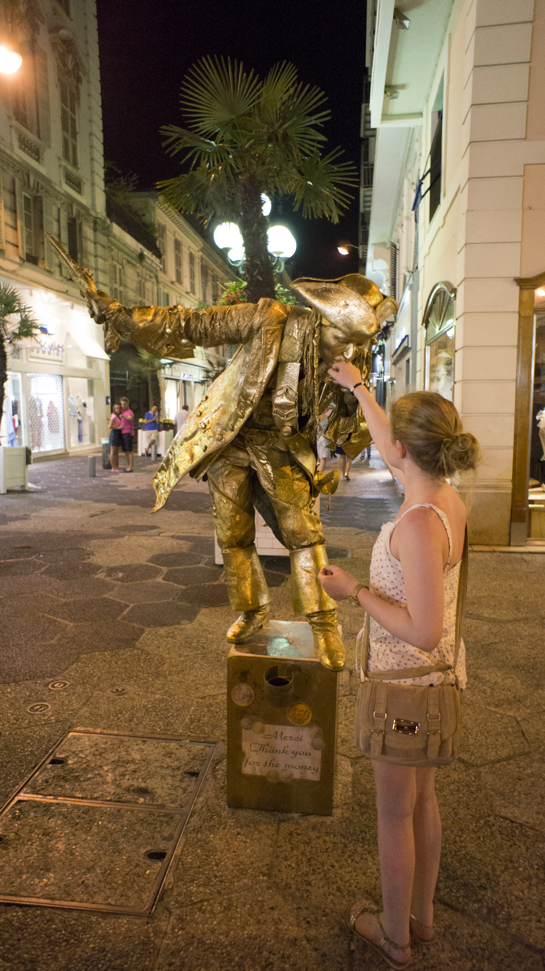 Zoe's first kiss ! There is abundance of street performances on the streets of Nice late into the night . . .