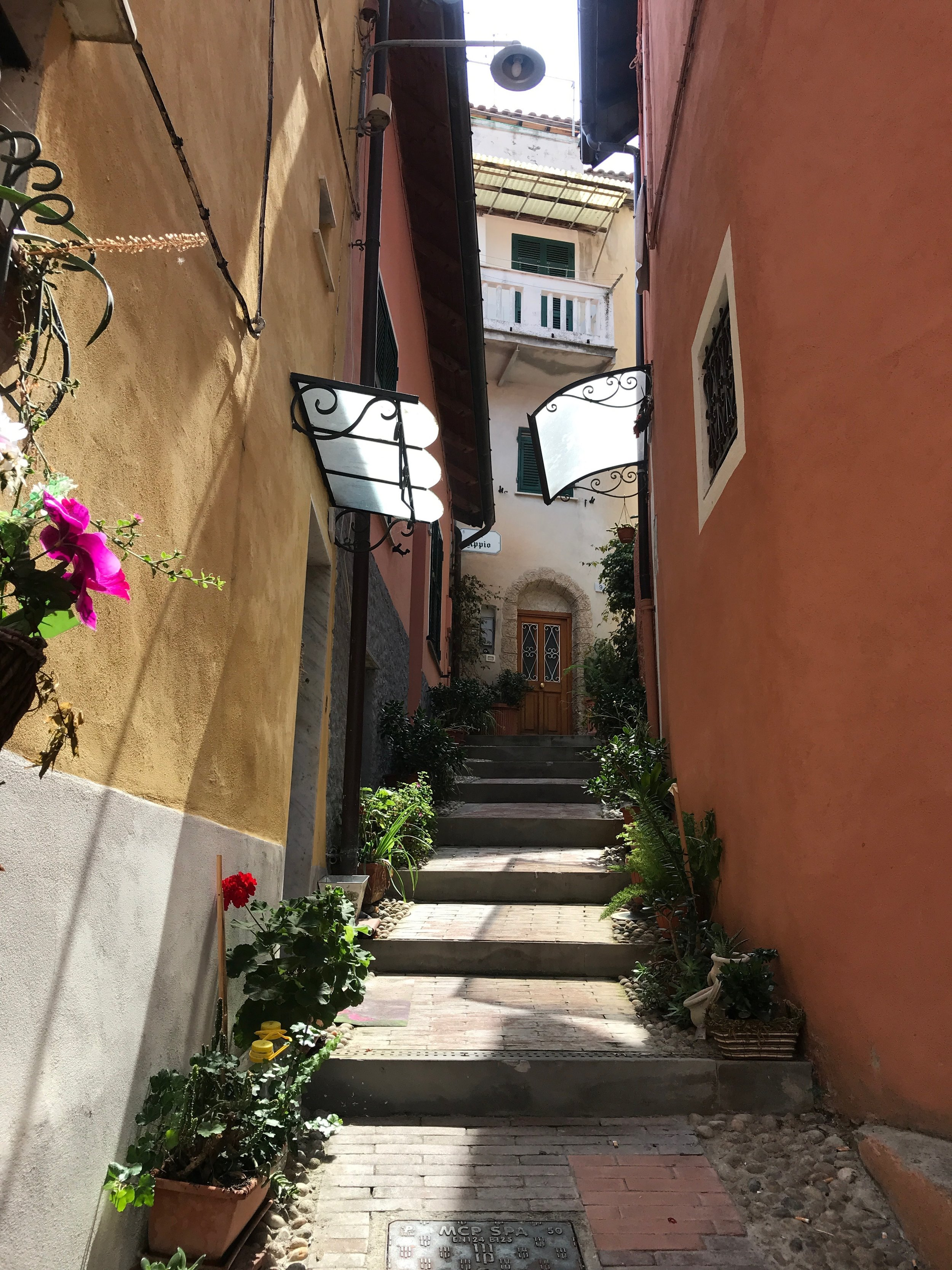 Ventimiglia backstreets. When you arrive in Ventimiglia walk straight down from the train station through the town, over and bridge and onto the beach which has lots of lovely eateries. Then explore the old cobbled streets - you will deserve an ice cream afterwards !