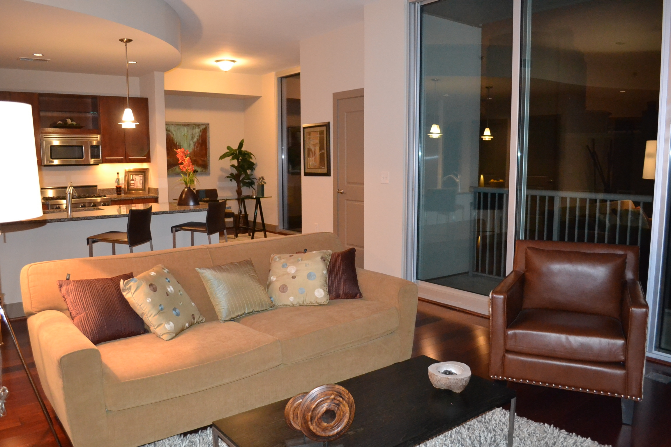 warm gold and brown hues create coziness in large Buckhead condo
