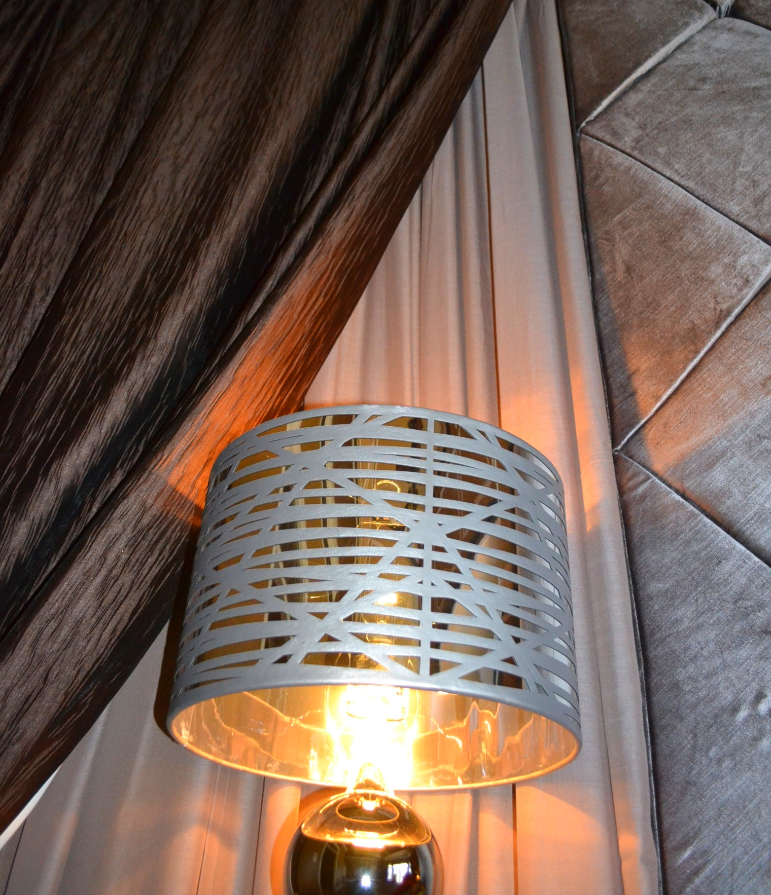 Translucent lampshade with leather cutout straps