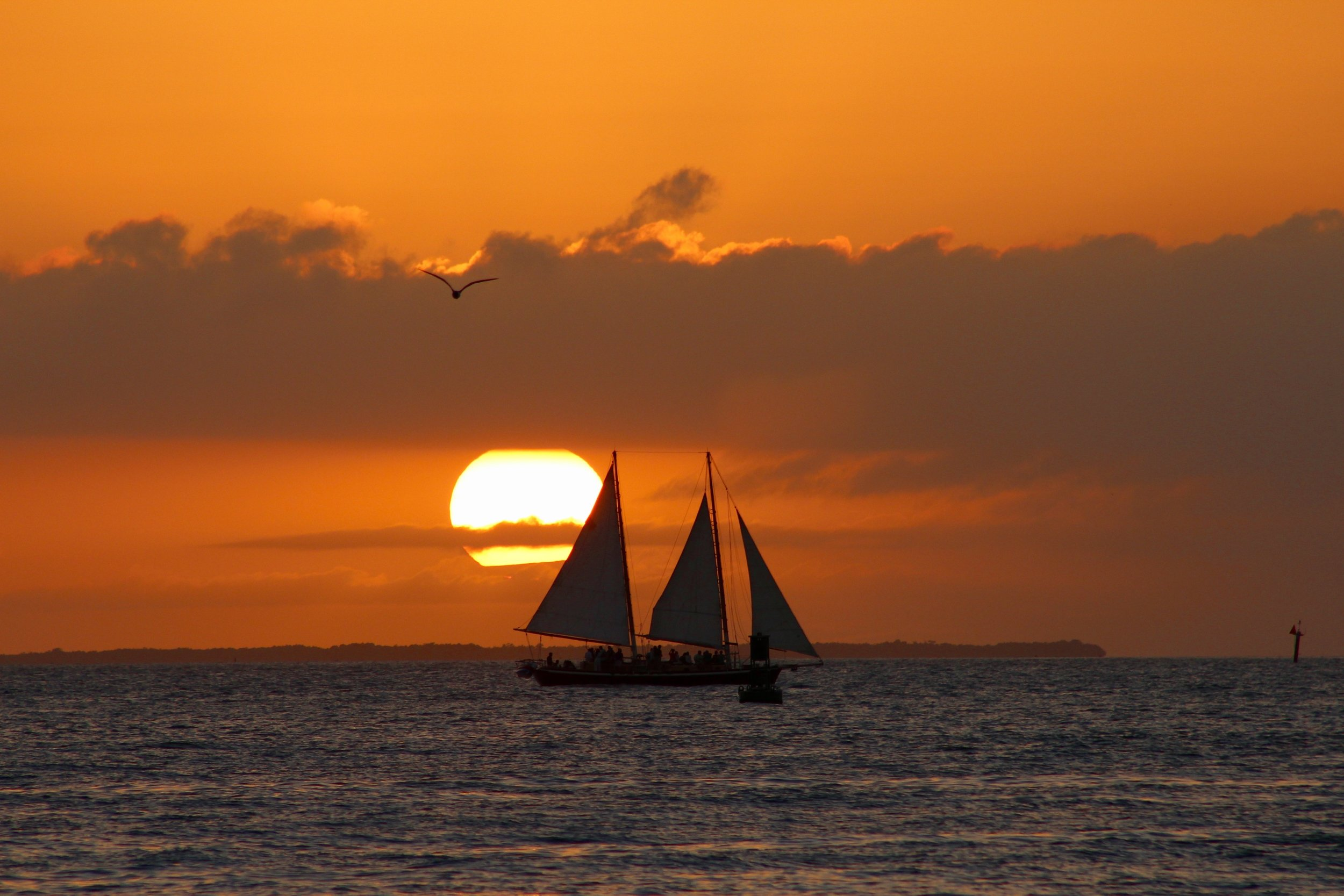 This sunset photo comes all the way from the Sunset Capital of the World, Mallory Square in Key West, Florida. The three-mast sailboat carries happy sunset cruisers, but also plays the role of a prop in the sunset photos of hundreds on land. While clouds streaked the sky, they did nothing but make the sunset that much more spectacular.