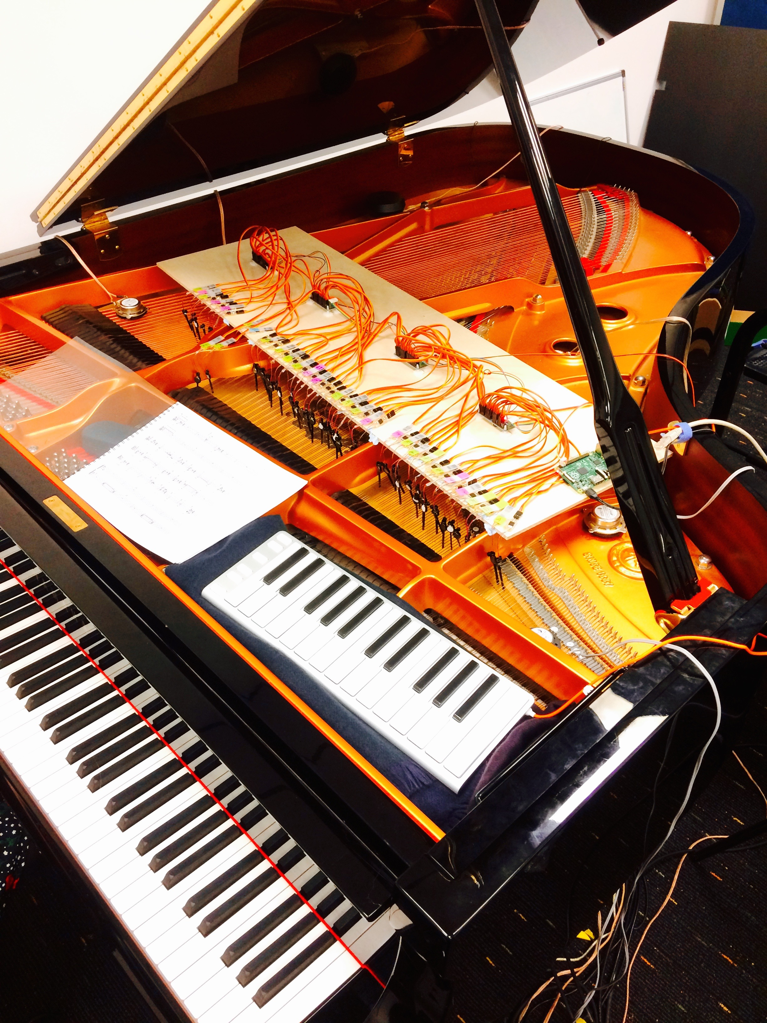 Robotic fingers, transducers, piano resonance feedback system installed in the piano at Goldsmith's Electronic Music Studio