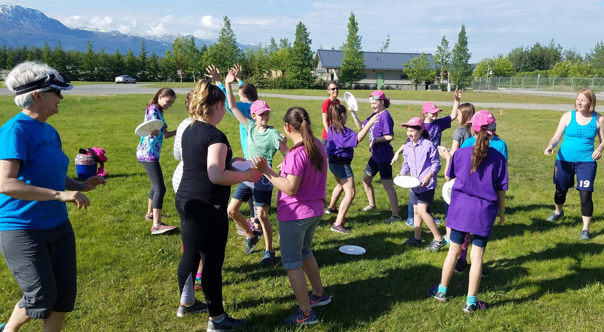 Girls scouts playing a spirit game called mingle to warm up and get to know each other at the start of the clinic.