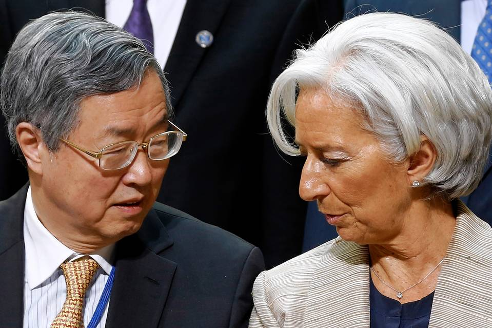 Zhou Xiaochuan, governor of the People's Bank of China, and Christine Lagarde, managing director of the International Monetary Fund.  Photo:  Jonathan Ernst/REUTERS