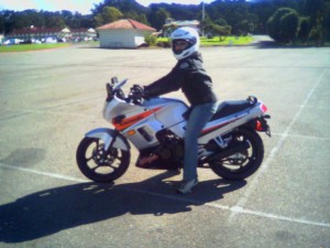 My first time ever, riding my Ninja in the parking lot (before I swapped the fairings for yellow)