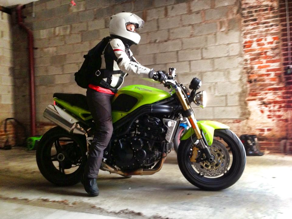 Me, on our 2007 Triumph Speed Triple. Wearing    Daytona Ladystars   . This bike is so tall it still didn't give me one flat left! But the little bit of traction I was able to use was extremely helpful when I had just my left foot down at stops.