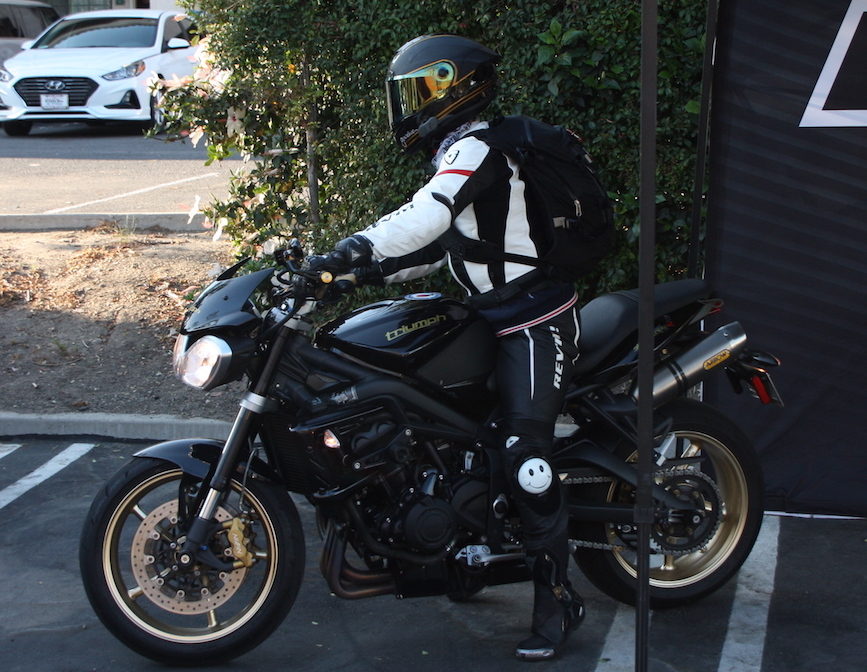 Me at the 2018 Women's Sportbike Rally West. I'm riding a friend's Street Triple which is coincidentally the same year and color as mine! It doesn't look like it, but it's actually taller than mine. LOL.