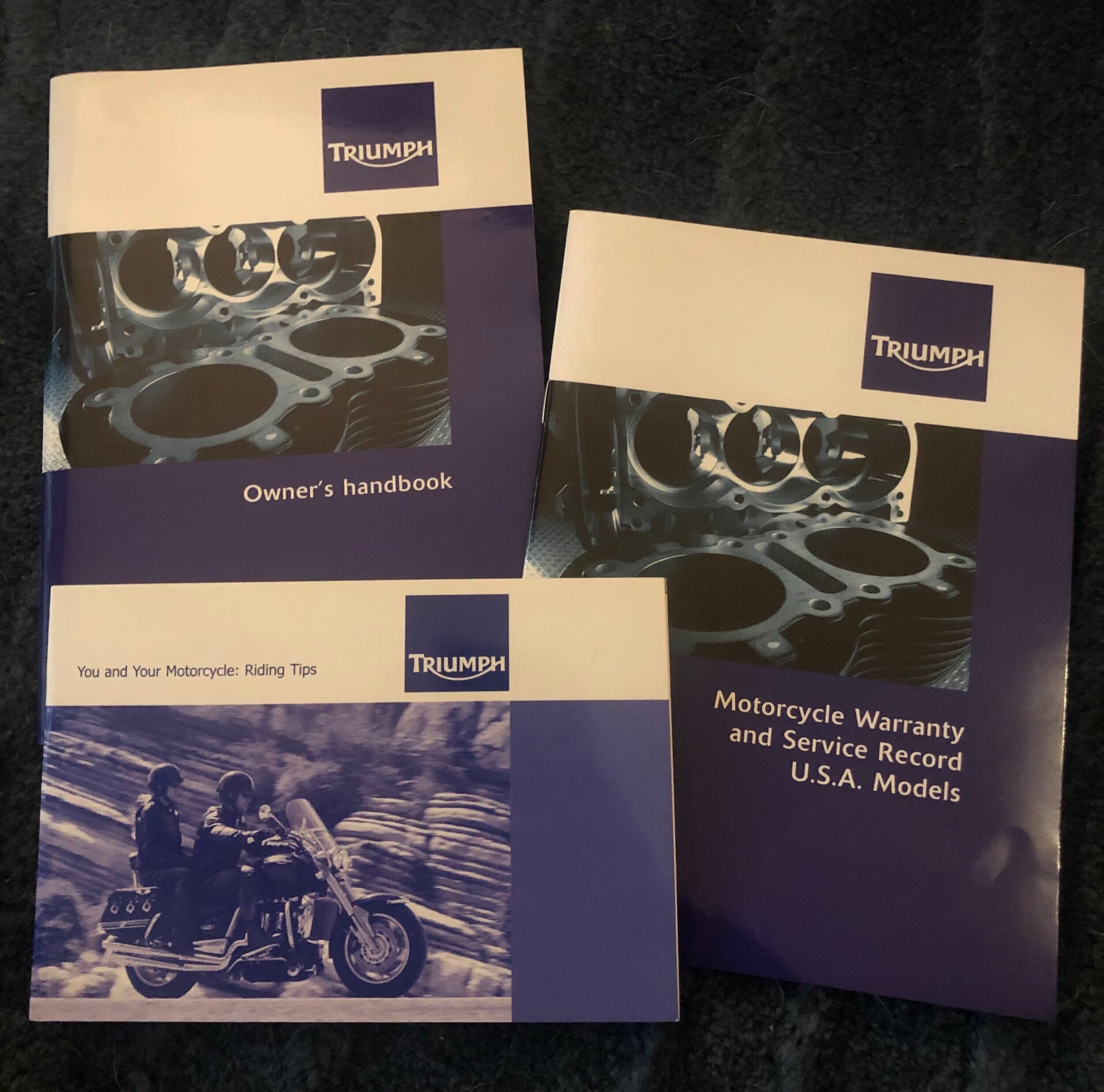 Mine came with 3 booklets: an Owners Handbook, Service Records Book and Riding Tips
