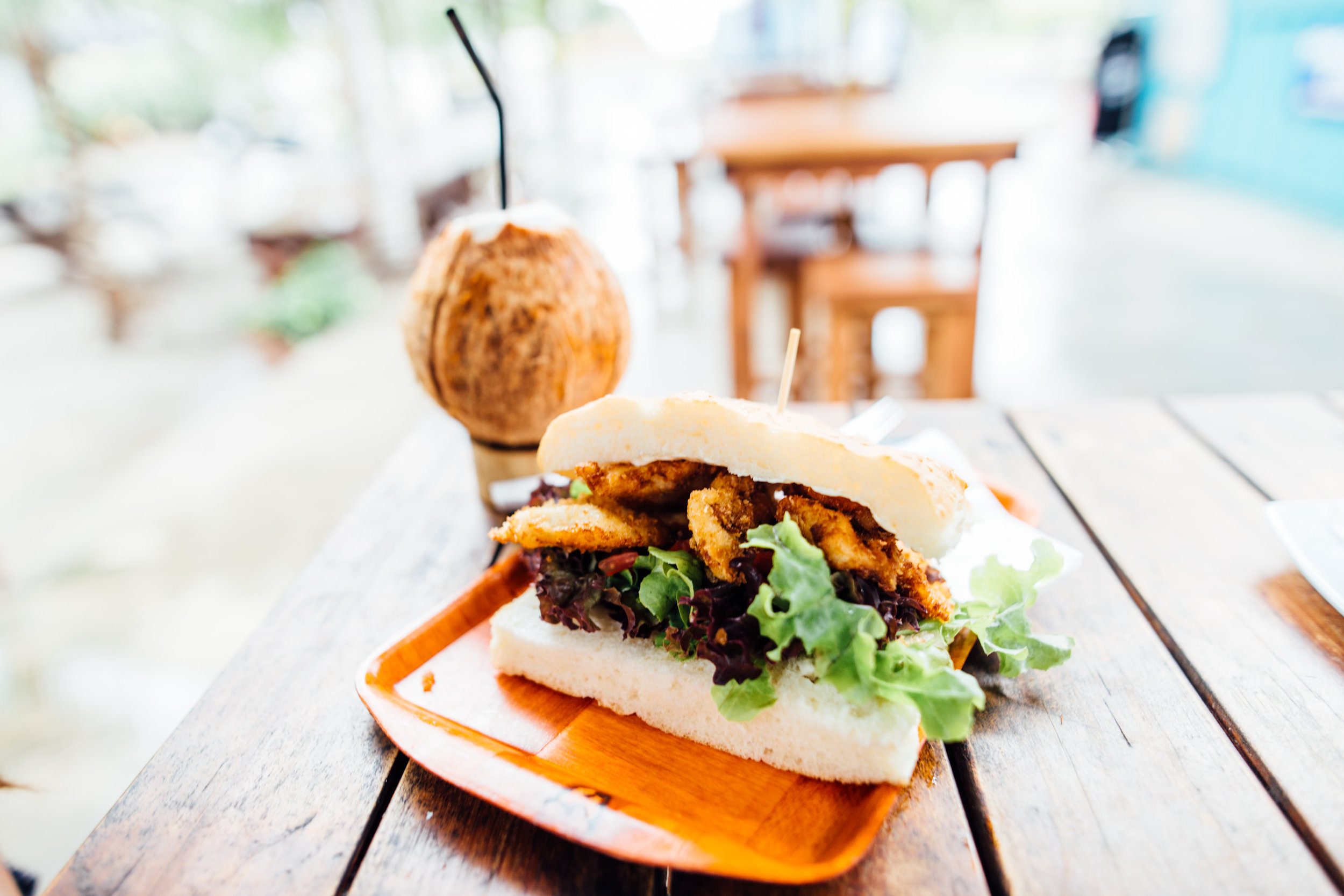 Easily the best fried fish sandwich of the dozen we tried on the island. And a coconut.