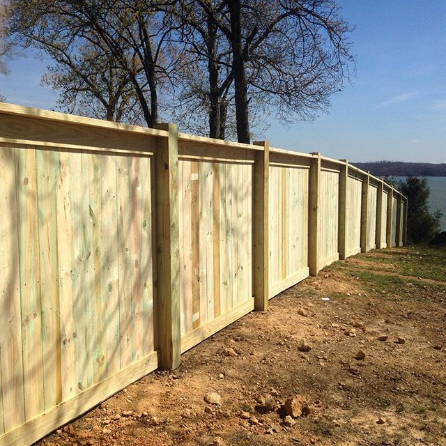 6ft tall, cap and trim, wood privacy fence completed in Murray, KY overlooking the lake! #fence #wood #candc #fenceline #kentucky #lake @murraykentucky