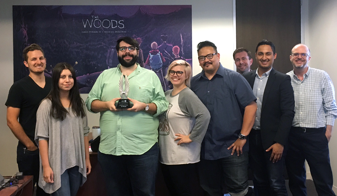 James Tynion IV recieving the award at the BOOM! Studios office in LA.