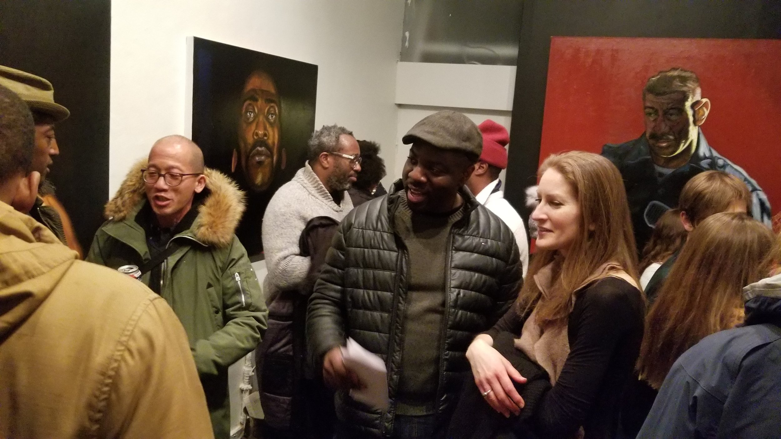 "Image from ""I See a Darkness"" opening, Feat. Artist - Sheldon Scott (gray sweater), Artist - Stephen Townes with the National Gallery's Alison Peil"