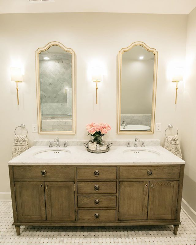 We wanted our master bath to feel like a Parisian hotel filled with old world elements such as these vintage mirrors, gilded sconces, and antique oak vanity. We have several more layers to add, which includes plans for a floral wallpaper. Stay tuned!